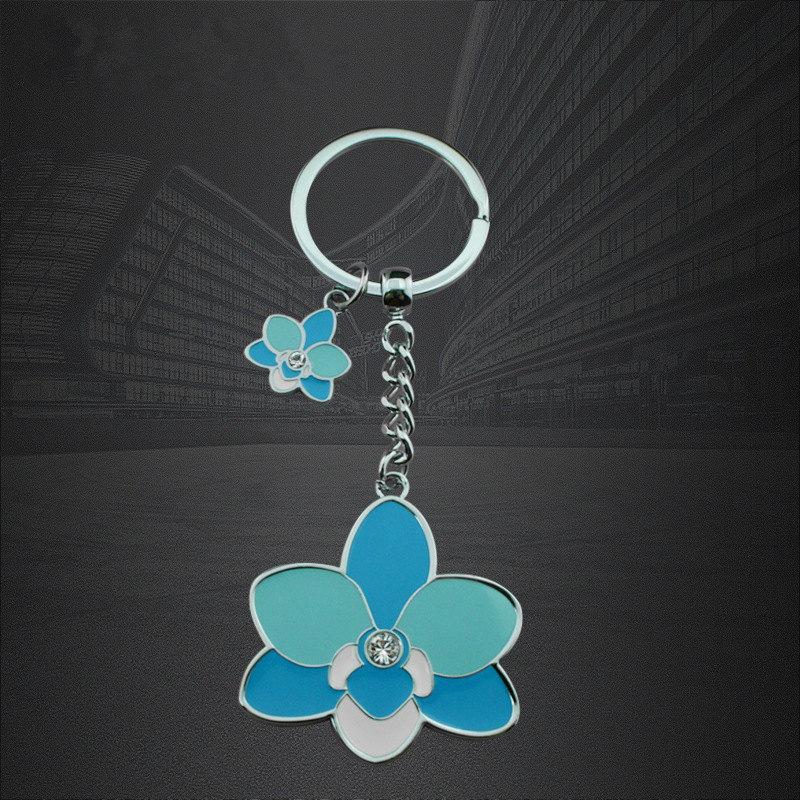 Gyártó egyedi cink-ötvözött virág alakú epoxi kulcs kulcstartó láncok